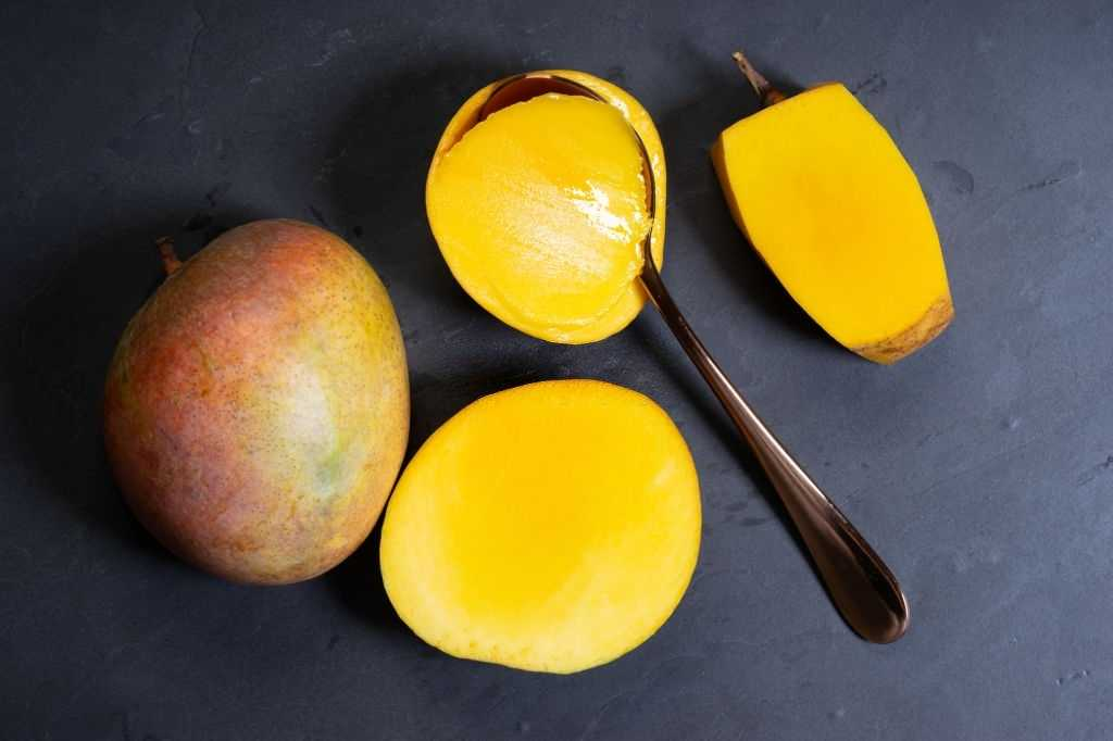 Scooping Mango With Spoon